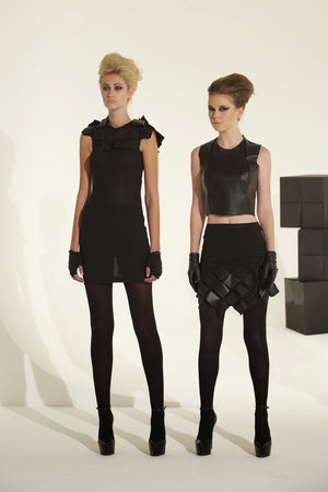 Short  black elastic skirt with origami vegan leather  hand folded cubes hem.