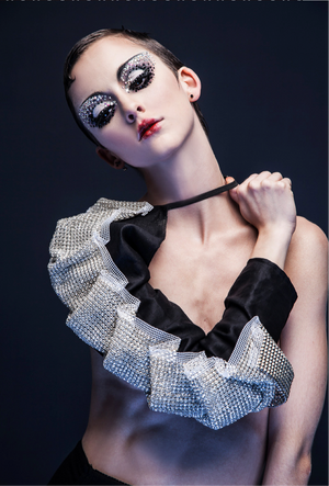 Swarorsky embellished fabric folded origami style and put on one sleeve black linen accessory.