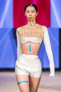 Gold woven leather grid with swaroski crystals  detailed  crop bra top and long white  stretch sleeves