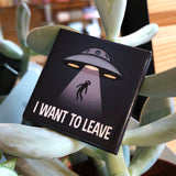 "Lot de 5 badges ""I want to leave"""