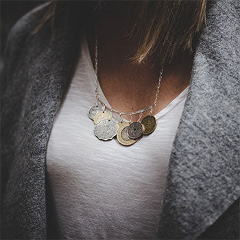 model wearing coin necklace