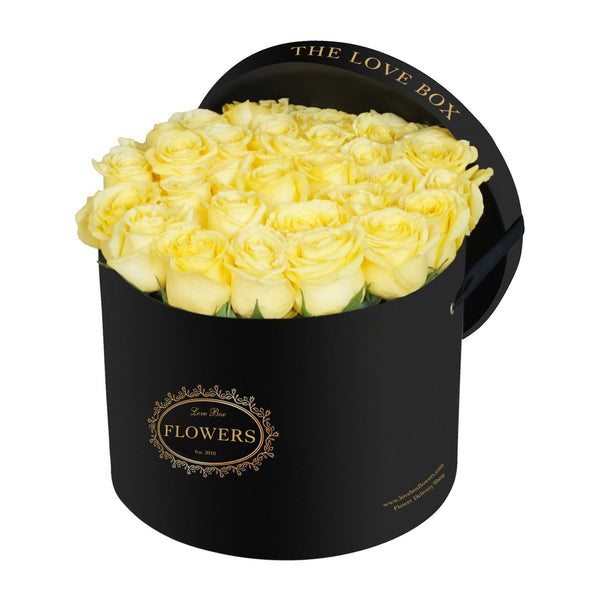 Yellow Roses in Large Black Box