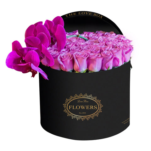 Purple Roses with Orchid Branch in Large Black Box