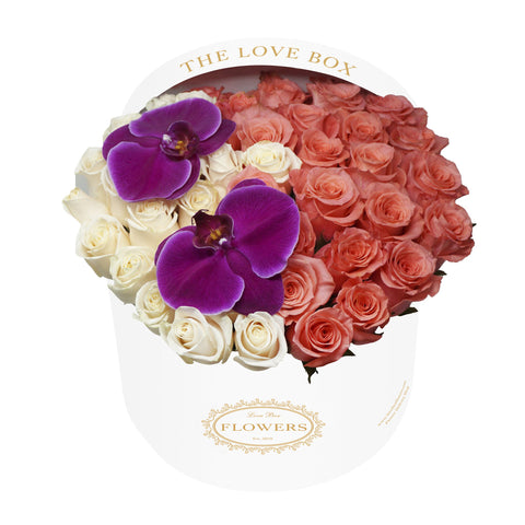 Roses and Orchid Flowers in Large White Box