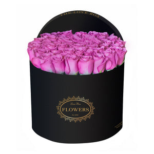 Purple Roses in Large Black Box