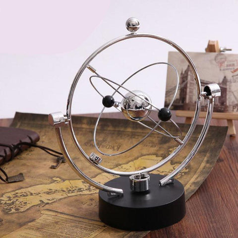 revolving cosmos perpetual motion toy - desk mess