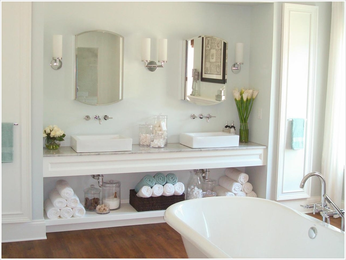 a bathroom vanity with an open shelf for storage