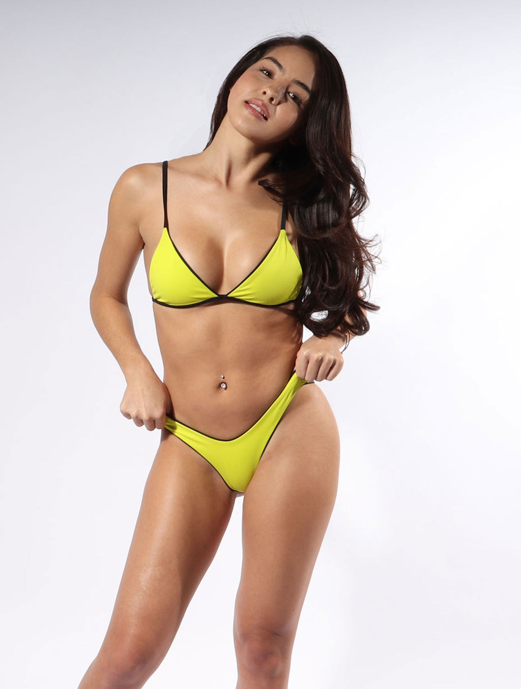 Taking our signature triangle design to another level, the Lucia bikini top in Limelight is a must have.