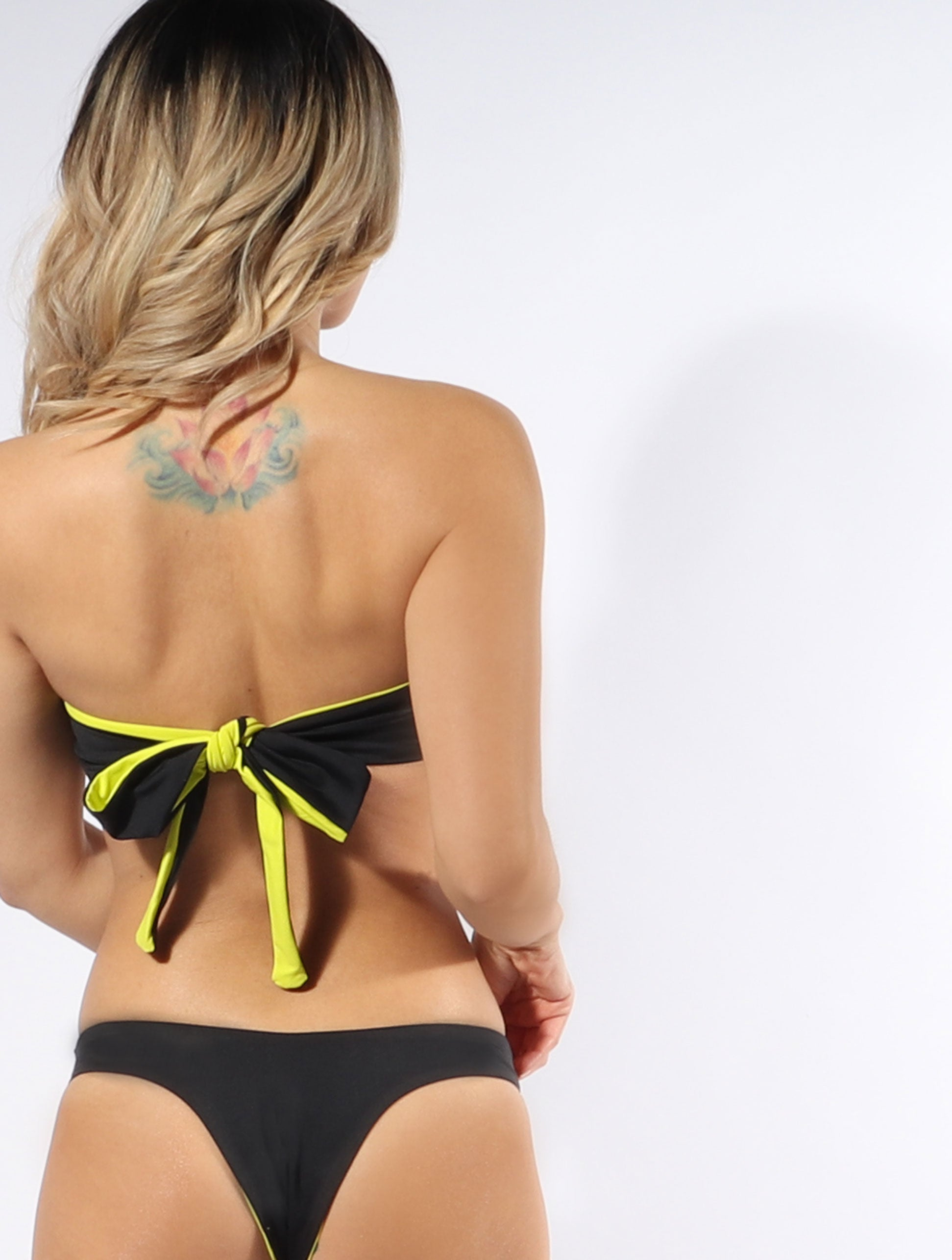 The Rosa bandeau bikini top in Limelight is both reversible and strapless with an easy tie-back.