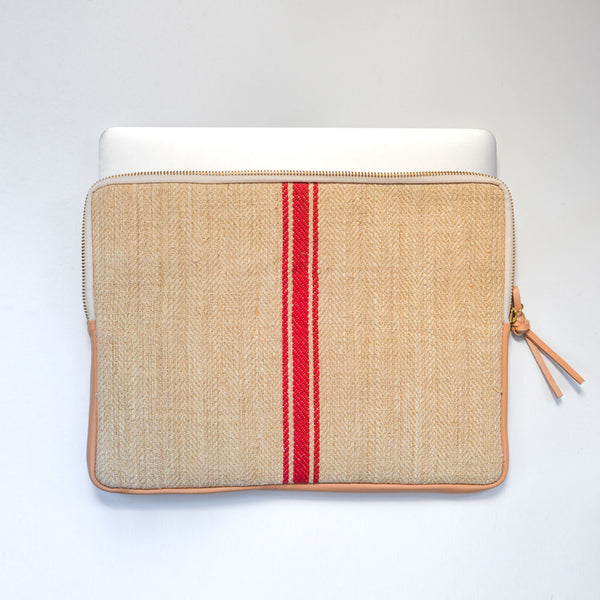 MacBook cover handcrafted  from a 100 years old grain sack and Spanish leather .