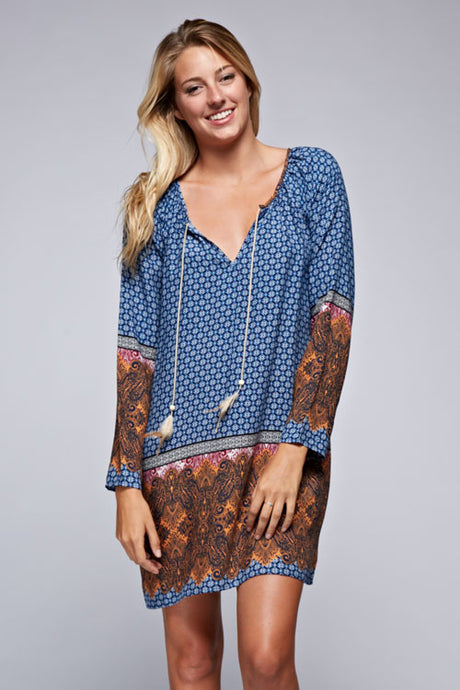 The effortless printed long sleeve tunic style mini dress. Features a feather tassel and intricate border trim.