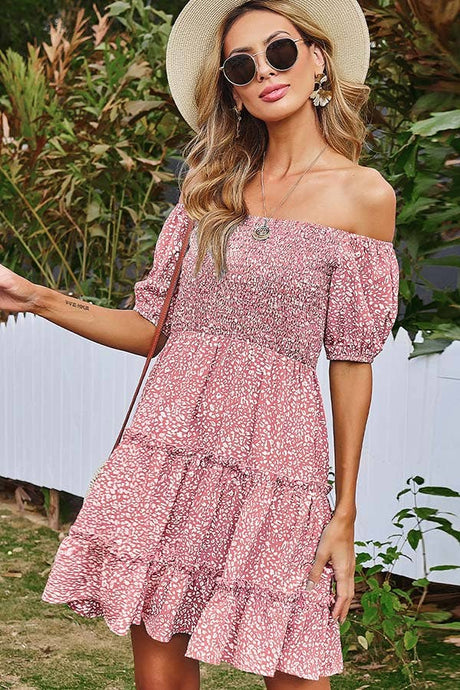 Off the shoulder puff sleeve dress. Light weight woven fabric cover in floral print creates this dress with an off shoulder neckline, short puff sleeve, smocked fitted bodice tops a tiered ruffled mini skirt