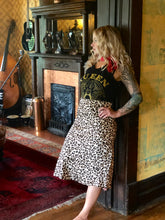 Leopard print butter satin long highwaisted skirt. Super flattering on all body types.  The elastic waistband makes this piece oh so comfortable. Dress up or wear with your favorite band tee for a modern twist.