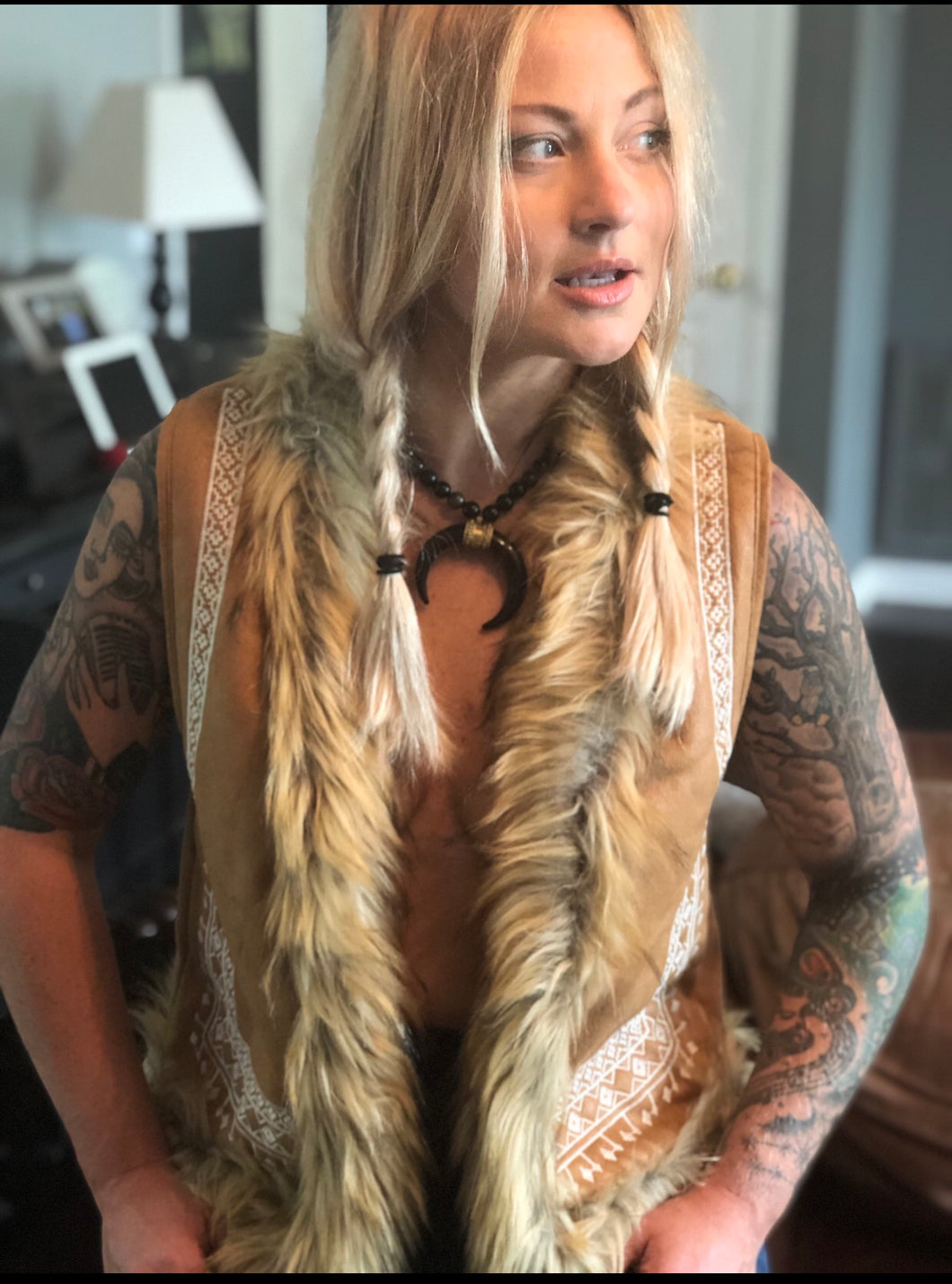 Embroidered vest with faux fur trim