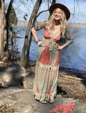 Our Boho maxi dress with eclectic print, V neckline, tassel detail at closing.
