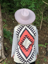 Stone washed, flap chest pocket jacket with a contrasting woven print sweater back accent.  boho jacket