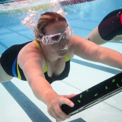 kirsty swimming with weight plate
