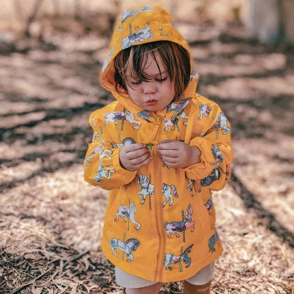 kids' colour changing raincoat yellow carousel design