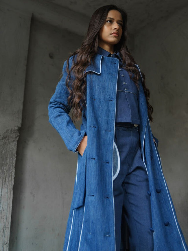 Natural Indigo Khadi denim long overcoat with flared bottom and piping details - JACKETS - IKKIVI - Shop Sustainable & Ethical Fashion