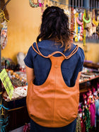 brown sustainable leather backpack image 2