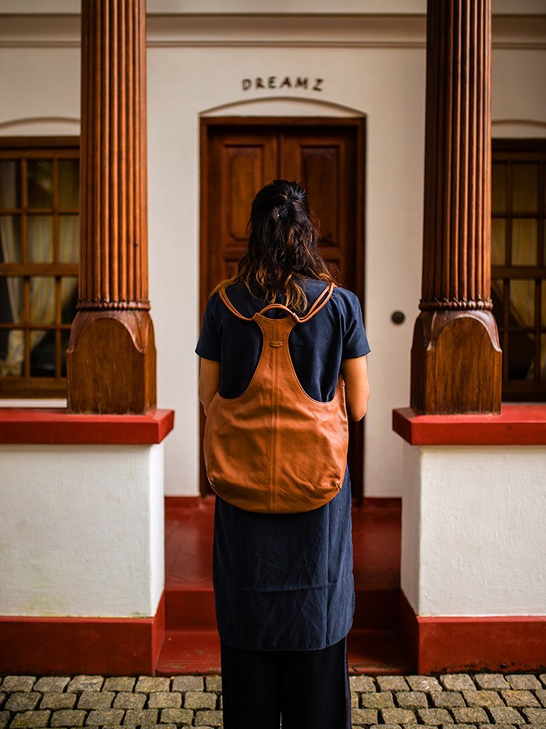 brown sustainable leather backpack image