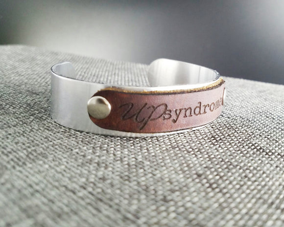 Up syndrome metal and leather cuff