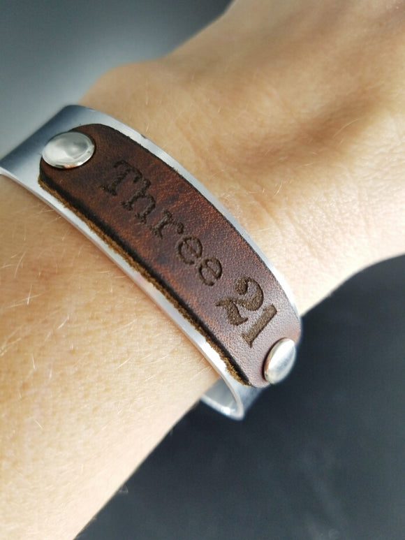Three 21 leather and metal cuff