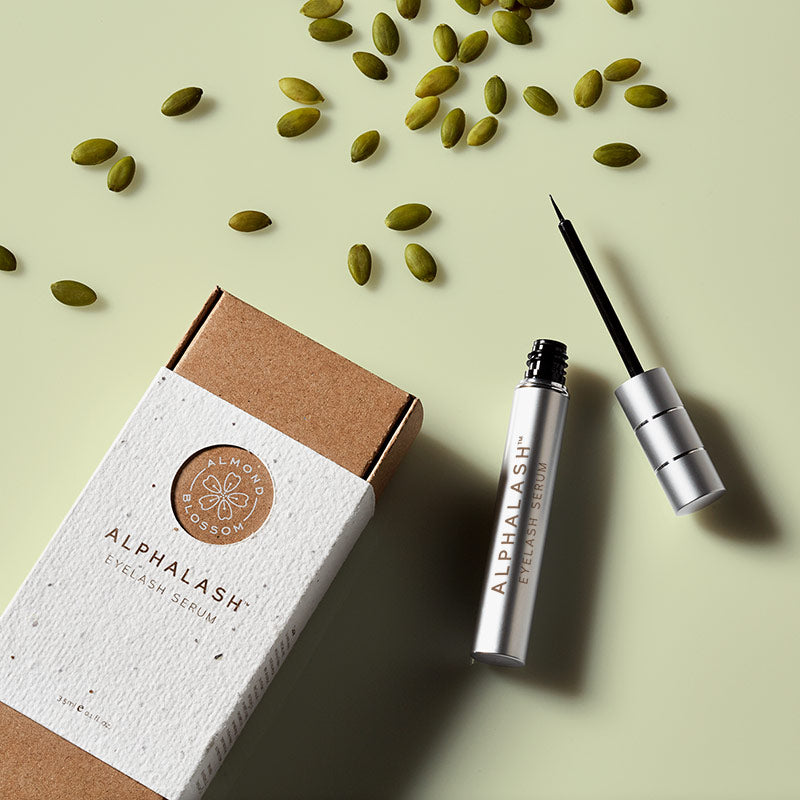 artistic flatlay image of the AlphaLash Eyelash Serum