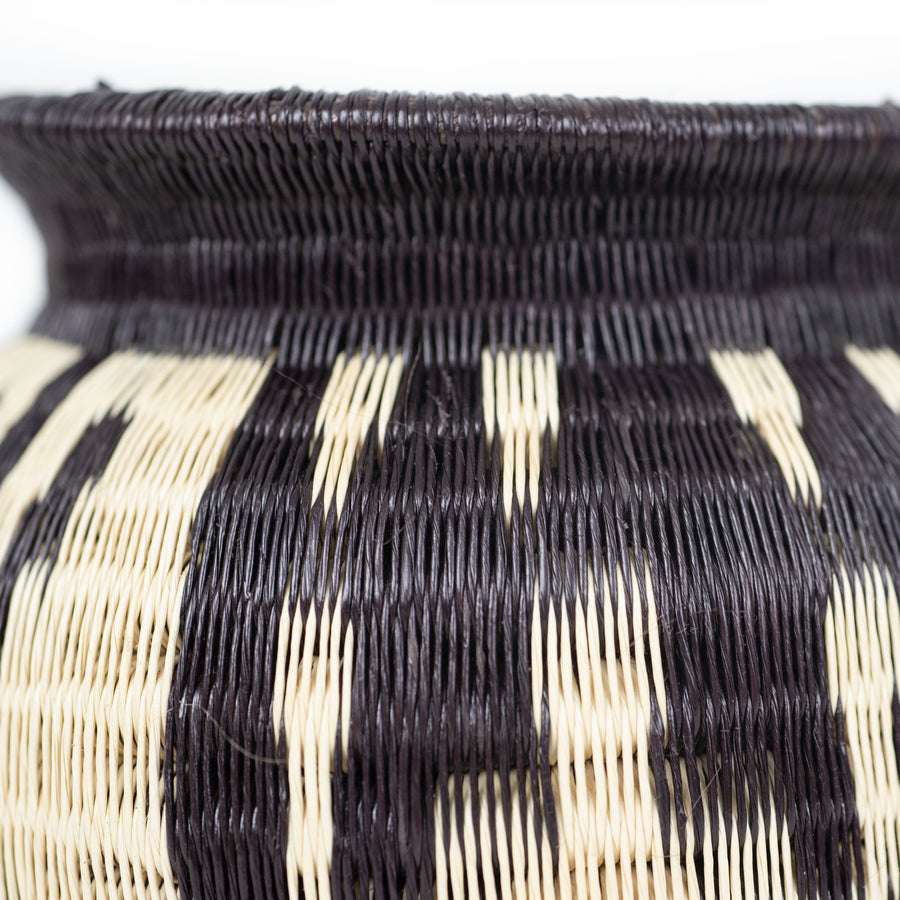 detail of small black and white werregue basket