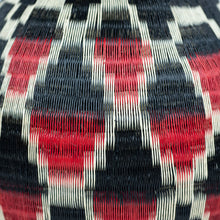 detail of red and black werregue basket