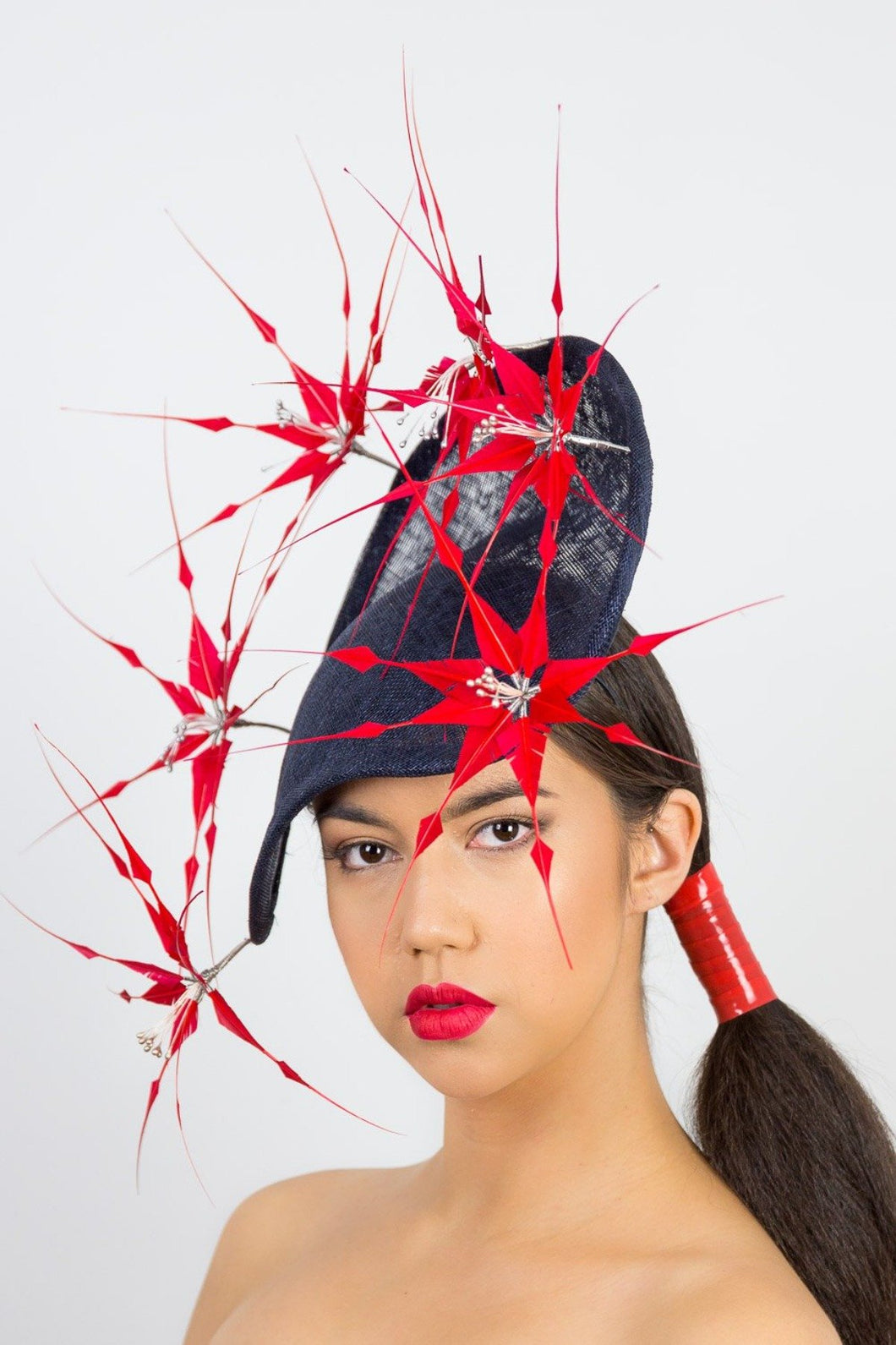ABI-Navy arched platter with red feather flowers by Felicity Northeast Millinery