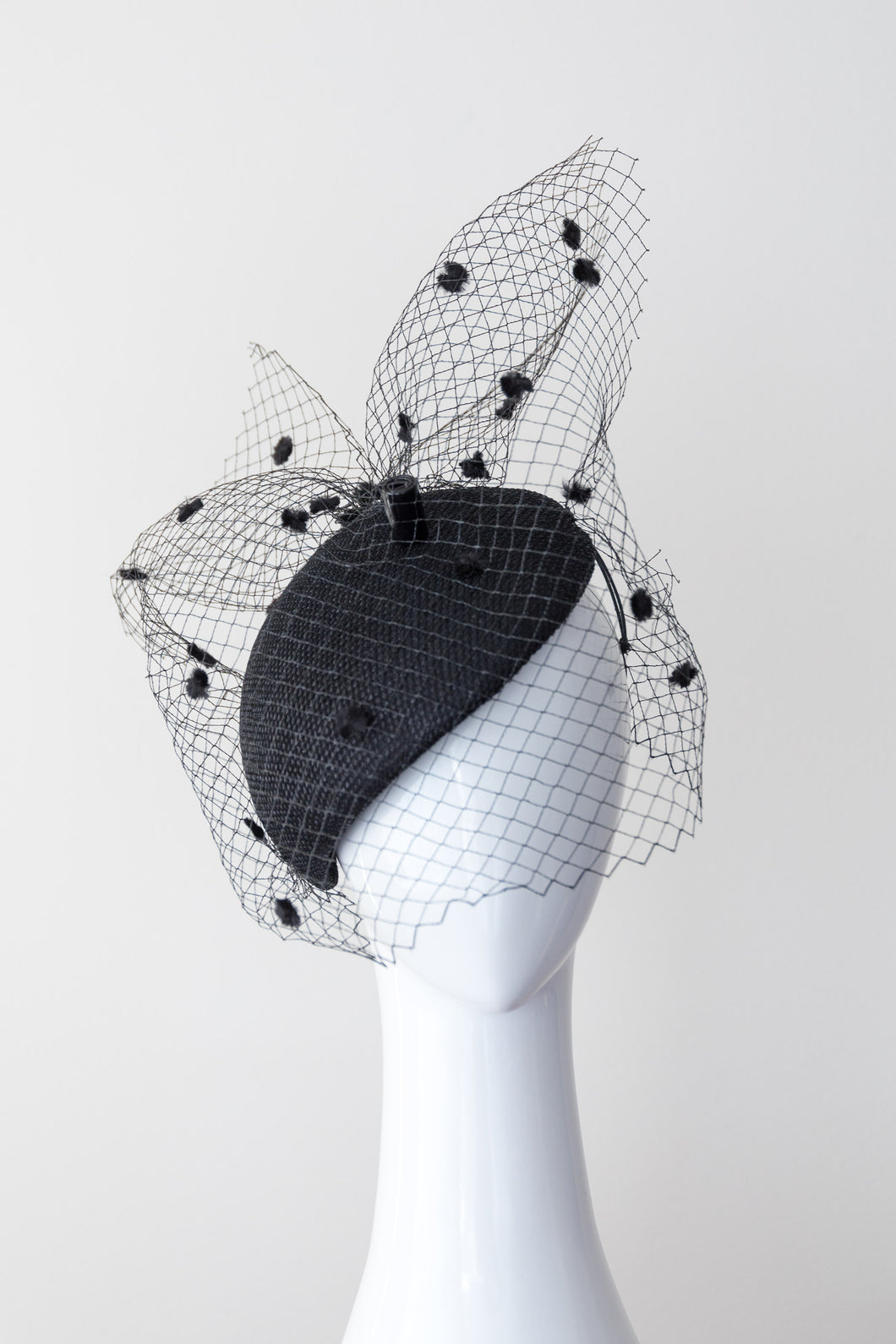 Black side beret with spotted veiling by Felicity Northeast Millinery