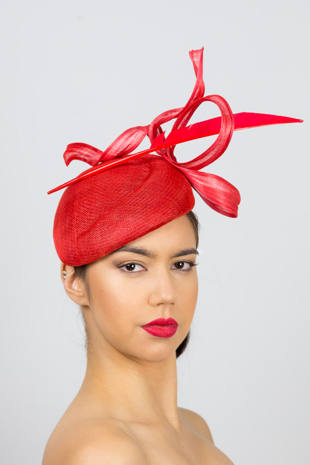 JOSIE- Red easy to wear side beret with feather and swirls
