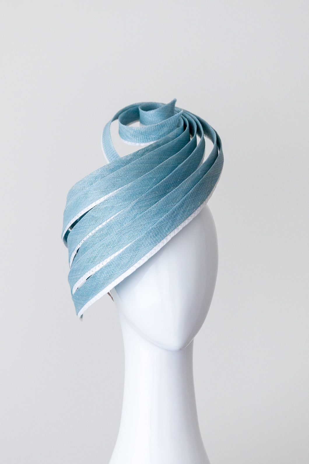 LEAH- pale blue sculptural hat with white highlights