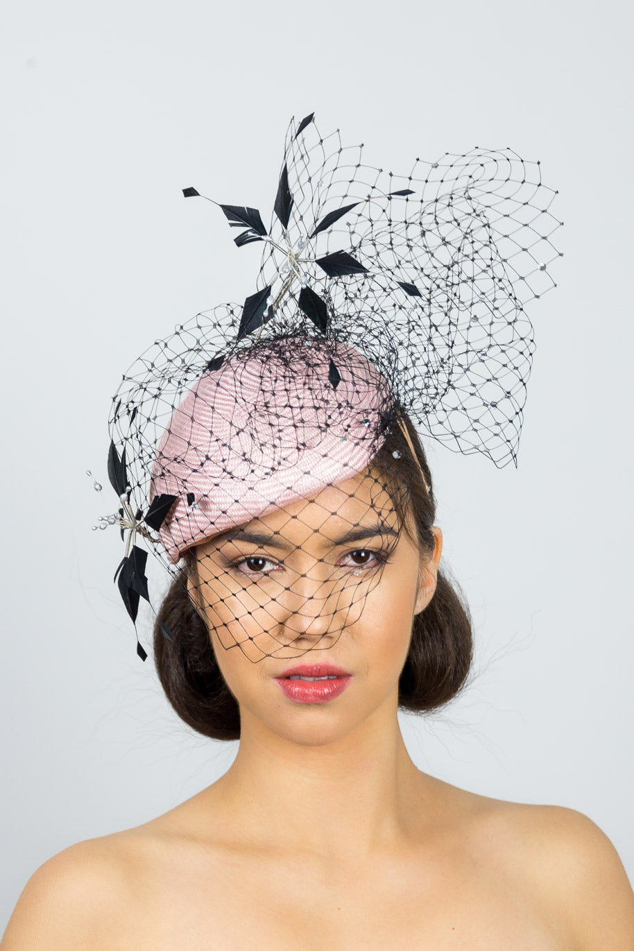 MIA-Side pink beret with black veiling and flowers