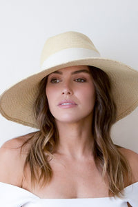 Natural panama fedora with soft brim and wide cream grosgrain ribbon