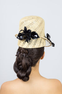 POPPY-tall open weave natural straw cap with black floral trim