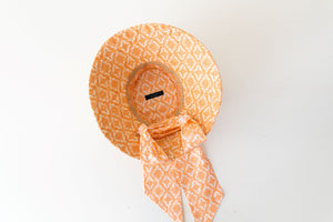 raffia and  orange and terracotta canvas bucket hat with scarf ,inside view