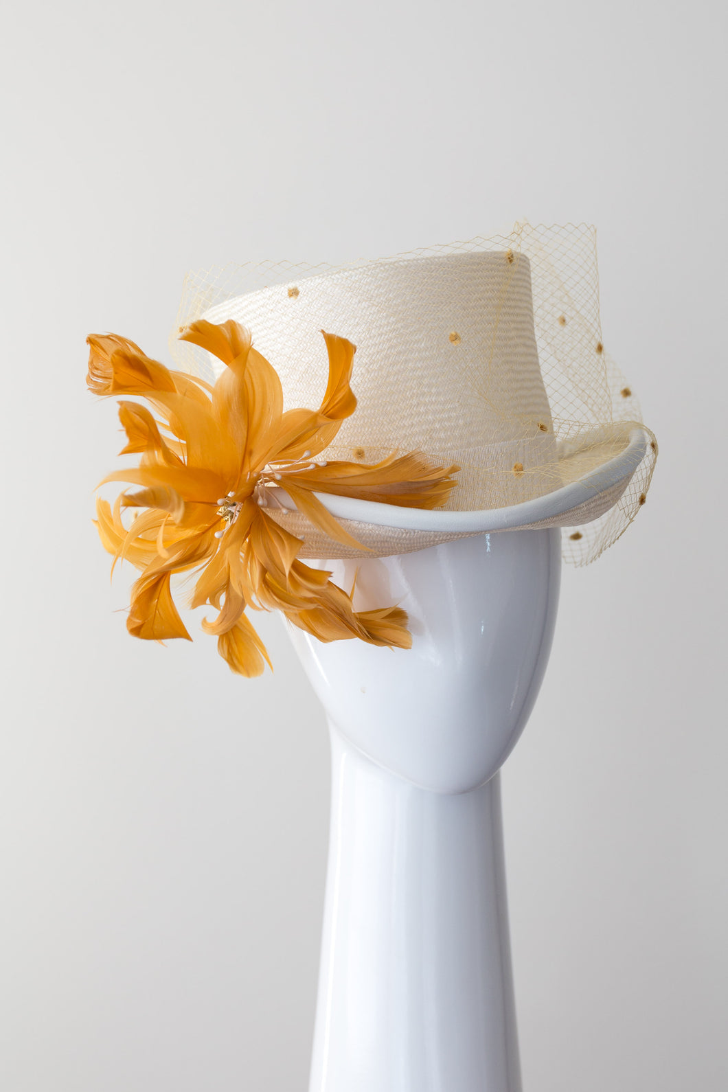 SIENNA-cream and mustard top hat with veiling and leather trim