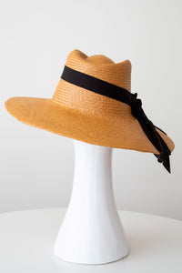 Tan fedora style sunhat with black ties and adjustable fit