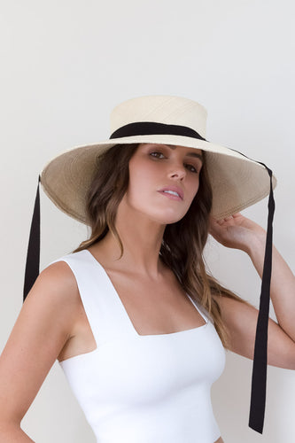 Wide brimmed cream panama sunhat with black ribbon ties