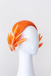 Orange bandeau with sweeping back feathers