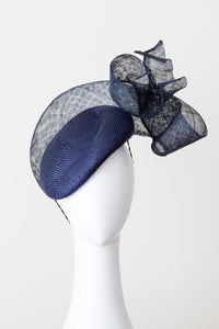 Floating sinamay bow on navy beret