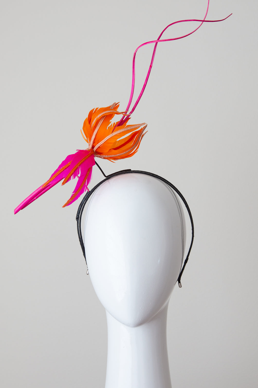 FINCH-Hot pink and orange feather flower on a headband