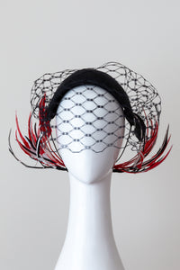 Wide Black Headband with Sweeping Back Feathers -Black, red and white veiled headband with back feather details by Felicity Northeast Millinery