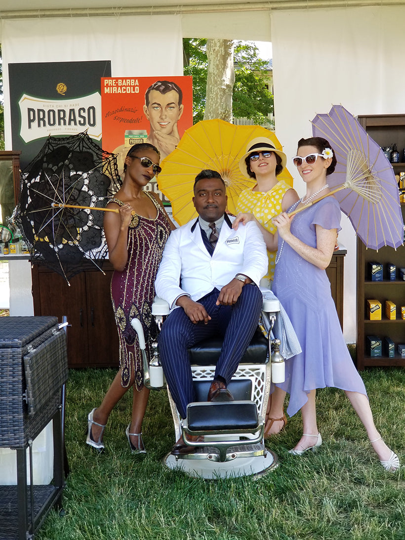 People dressed up in 1920's attire for Jazz Age Lawn Party