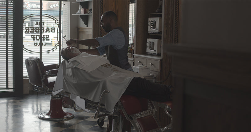 Getting a shave at The Barbershop Club