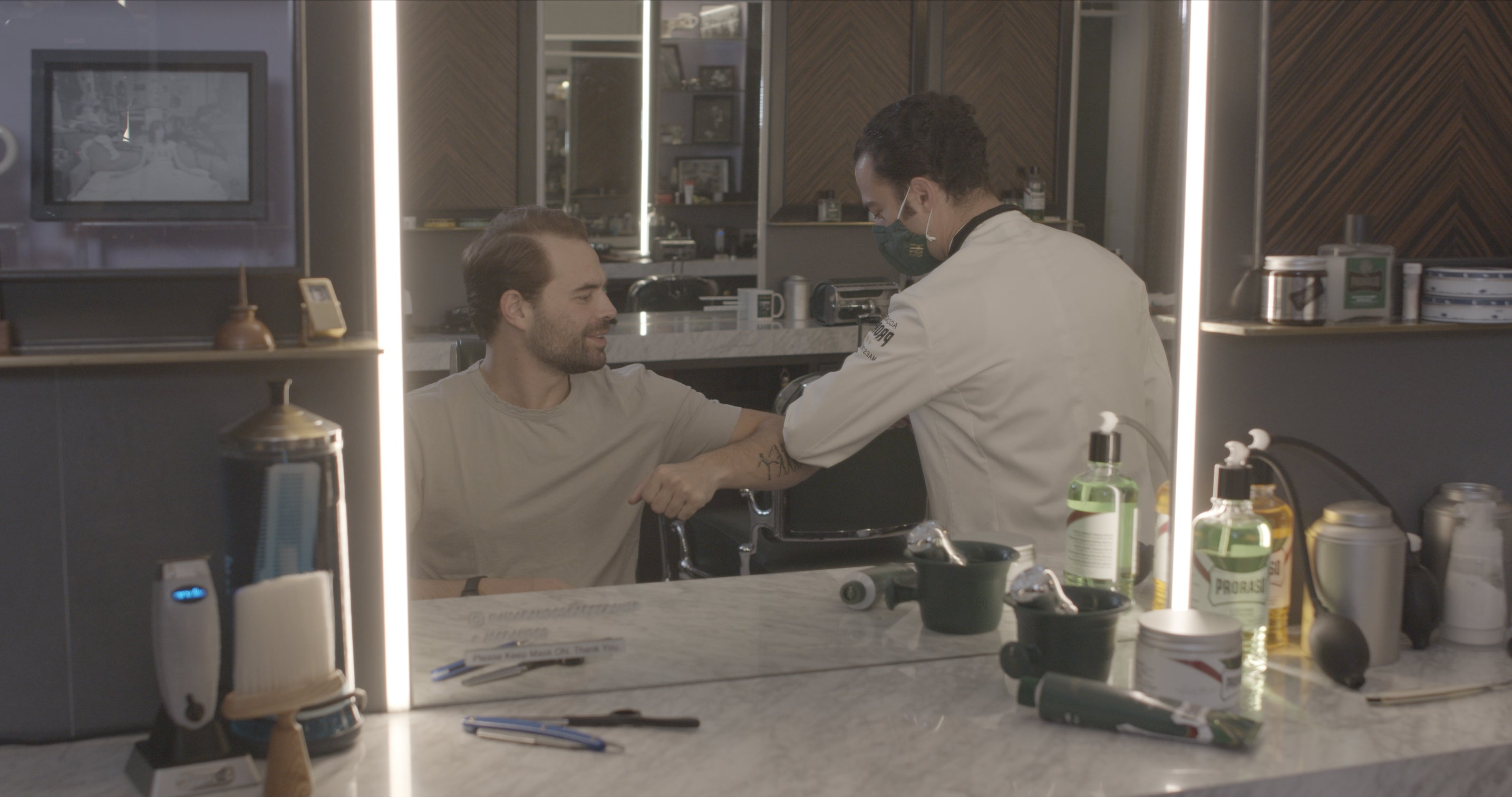 Mike and Alec greeting one another at Haar & co Barbershop