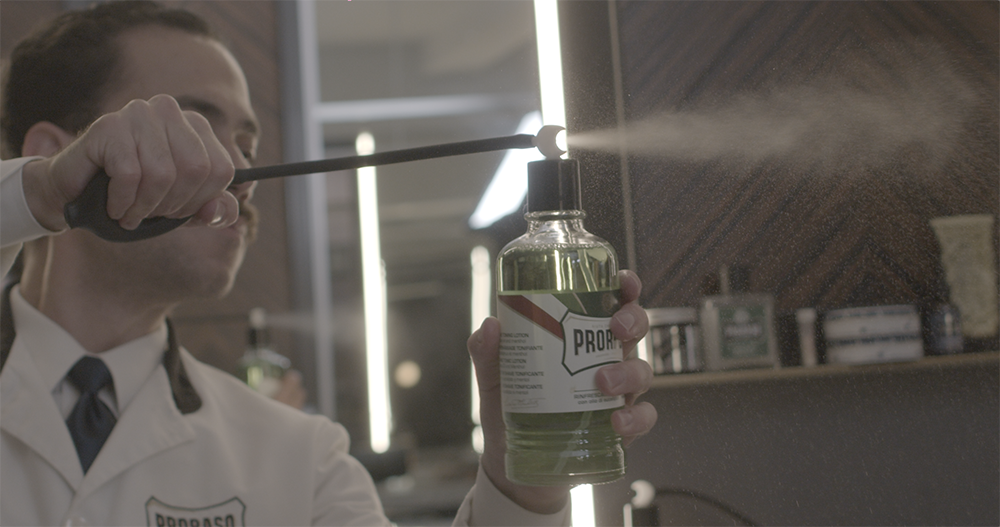 Michael Haar mists a client with Proraso after shave lotion at Haar & Co Barbershop