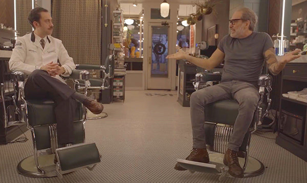 Mike and Frank talking in the barbershop
